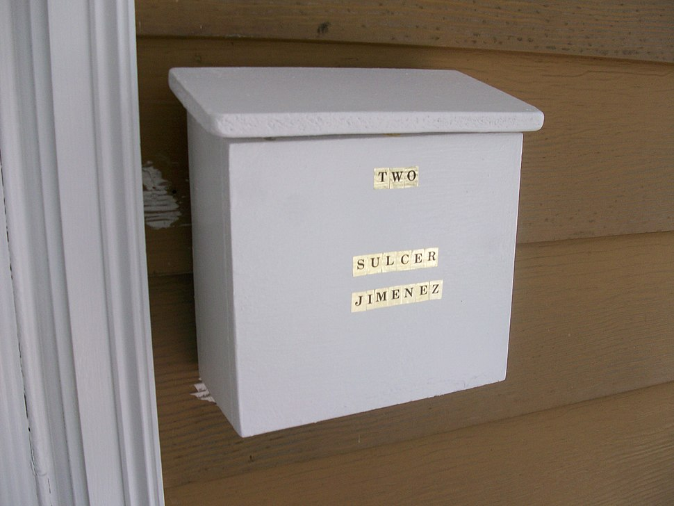 Mailbox built from particle board with hinges