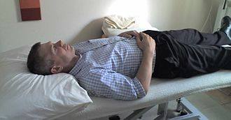Supine position - A man lying in the supine position