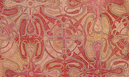 The Mandala Chandar (c. 1840, detail) is an unusual Kashmiri tantric moon shawl (chandar) with a mandala to the centre from which radiates zoomorphic tendrils, filled with multi-coloured millefleurs on a pink ground. Mandala Chandar, Kashmir 1840.jpg
