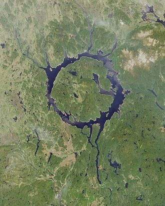 "Daniel-Johnson Dam - The Manicouagan Reservoir has been nicknamed the ""Eye of Quebec"". Daniel-Johnson Dam is located towards the bottom of image, beginning of reservoir."
