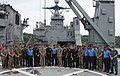 Marines assigned to 15th MEU and sailors aboard the amphibious dock landing ship USS Pearl Harbor (LSD 52) pose for a group pictures during an amphibious warfare subject-matter-expert exchange with Indian military counterparts in Goa.jpg