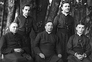 Maryknoll - Fathers Thomas F. Price, seated at left, and James A. Walsh, seated at center, co-founders of the Maryknoll Fathers and Brothers, pose for a photo with fellow Maryknoll Fathers James E. Walsh, seated at right, Francis X. Ford, standing at left, and Bernard Meyer, at Maryknoll, N.Y., in 1918.