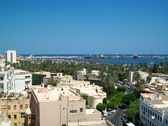 Port of Tripoli - View of the Maydan Jazair Park from the Safwa Hotel on Baghdad Street in the Italian quarter of Libya's capital Tripoli. To the left of the park is the Grand Hotel and in the background is the Port of Tripoli