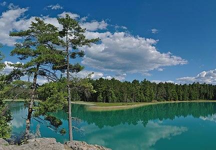 Emerald water of meromictic McGinnis Lake, Petroglyphs Provincial Park, Ontario, Canada.
