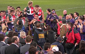 Shaun McManus - McManus being chaired from the ground after his final match
