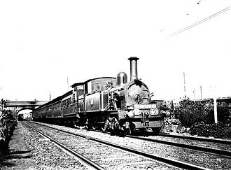 Railways in Melbourne - Steam-hauled suburban train departing North Melbourne station for Sunshine.