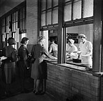 Members of the Women's Auxiliary Air Force catering section serve meals to WAAFs at the Royal Air Force depot in Uxbridge, 1944. D22232.jpg
