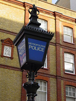 A traditional blue lamp as seen outside most p...