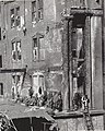 Missouri Athletic Club fire wreckage at the northwest corner of Fourth Street and Washington Avenue. Workers' discarded jackets line the wall in the burnt out third floor.jpg