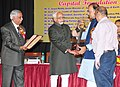"""Mohd. Hamid Ansari presenting the Capital Foundation Award to the Leader of Opposition, Rajya Sabha, Shri Arun Jaitley, at the """"Capital Foundation Annual Lecture and award ceremony, in New Delhi on September 07, 2013.jpg"""