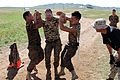 Mongolian service members run through a pepper spray qualification course during Non-Lethal Weapons Executive Seminar (NOLES) 13 at Five Hills Training Area, Mongolia, Aug. 21, 2013 130821-M-DR618-133.jpg