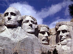 The faces of (left to right) George Washington...