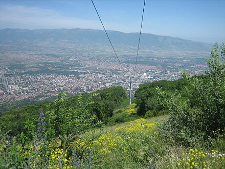 Skopje as seen from Mount Vodno. The cable car cables are also visible.