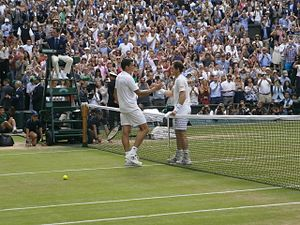 2016 Wimbledon Championships - Andy Murray shakes hands with Milos Raonic at the completion of the men's singles final.