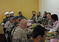 Muslim scholars serving with a Jordanian Engagement Team, top left, have lunch with Afghan National Army soldiers and U.S. Soldiers assigned to the 320th Tactical Psychological Operations (PSYOP) Company, 12th 130424-A-UO630-001.jpg