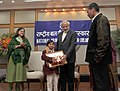 Narendra Modi conferring the National Awards for Bravery 2014 to Mhonbeni Ezung who saved the life of her grandmother, who fell into a river, in New Delhi. The Union Minister for Women and Child Development.jpg