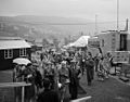 National Eisteddfod of Wales, Ebbw Vale, 1958 - Visitors in the rain (4860243776).jpg