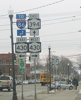 New York State Route 394 - The intersection of NY 394 and NY430 comprises the main intersection of the village of Mayville. Chautauqua Lake is visible in the background.