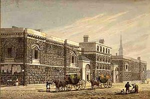 Engraving of large dark stone-block building, with horse-drawn carriages in the street in front