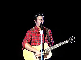 Nick Jonas - Jonas performing live as part of the Jonas Brothers in 2010.