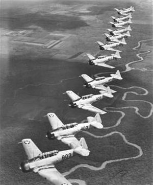 Victoria Regional Airport - A twelve-ship formation over the Guadalupe River in the vicinity of Foster Field, Texas, Summer 1942