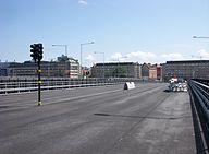 Den den Nye Solnabron i september 2010 (venstre) og i juli 2011 (højre)