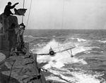 OS2U approaching USS South Dakota (BB-57) in 1943.jpg
