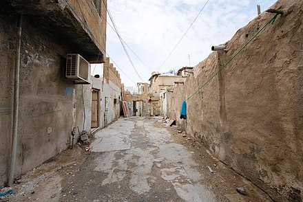An old district in Doha planned with narrow streets and rough plastered walls gives a glimpe of the city's past. OldDistrictDoha.jpg