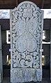 Old tombstones on display at the graveyard (kirkegård) by Sør-Fron Church (Gudbrandsdalsdomen kirke 1792) Hundorp Gubrandsdalen Norway 2017-03-23 Spring sun IMG 1954.jpg