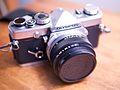 Olympus OM-1 with a FZuiko Auto-S 50mm f-1.8 lens.jpg