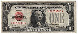 A gold-standard 1928 one-dollar bill. It is id...