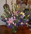 Orchid arrangement in vase.jpg