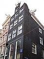 Oudezijds Achterburgwal 57 corner with Monnikenstraat.JPG