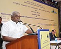 P. Radhakrishnan addressing at the Inception Day of National Highways and Infrastructure Development Corporation Limited (NHIDCL), in New Delhi on July 20, 2015.jpg