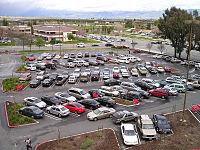 Parking lot showing diagonal parking pattern designed for one-way traffic.