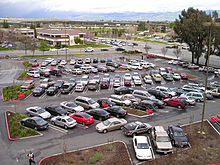 A California parking lot in 2006, with landscaping and a diagonal parking pattern designed for one-way traffic.