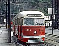 PAAC PCC 1664, a -48 ARLINGTON car, approaching P&LE transfer along Smithfield St. in Pittsburgh, PA on September 1, 1965 (26857615695).jpg
