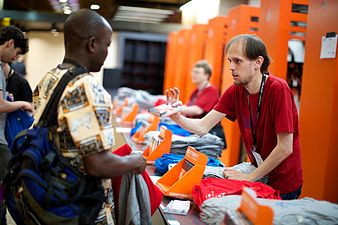 Participants getting a bag, t-shirt, notebook and brochures.jpg