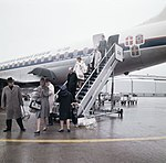 Passengers leaving aeroplane at Arlanda airport in Stockholm about 1965 (6082316188).jpg