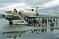 Passengers queue to board airplane in rainy weather, 1971.jpg