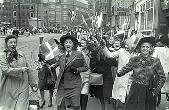 People celebrating the liberation of Denmark at Stroget in Copenhagen, 5 May 1945. Germany surrendered two days later. People celebrating the liberation of Denmark. 5th May 1945. At Stroget in Copenhagen..jpg