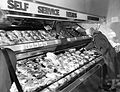 People serving themselves at the Bergs Supermarket meat section, circa 1950 (6327551210).jpg