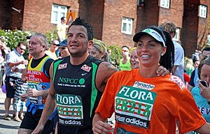 Peter Andre and Katie Price (Jordan) running i...