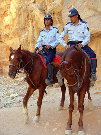 English: mounted Tourist-Police officers in Pe...