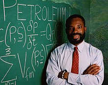 Philip Emeagwali with scribbled Exxon-Mobil equations.jpg