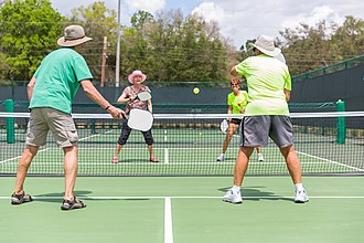 Pickleball - A doubles game of pickleball at the Villages in Florida.