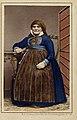Porträtt av sittande kvinna iklädd sockendräkt som vilar armen på bord i nyrokoko. Herrestad i Skåne - Nordiska Museet - NMA.0042849.jpg