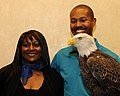 Posing for picture with Bald Eagle. (10594240655).jpg