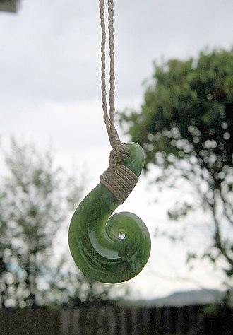 Pounamu - Pounamu hei matau pendant, a heavily stylized fishhook