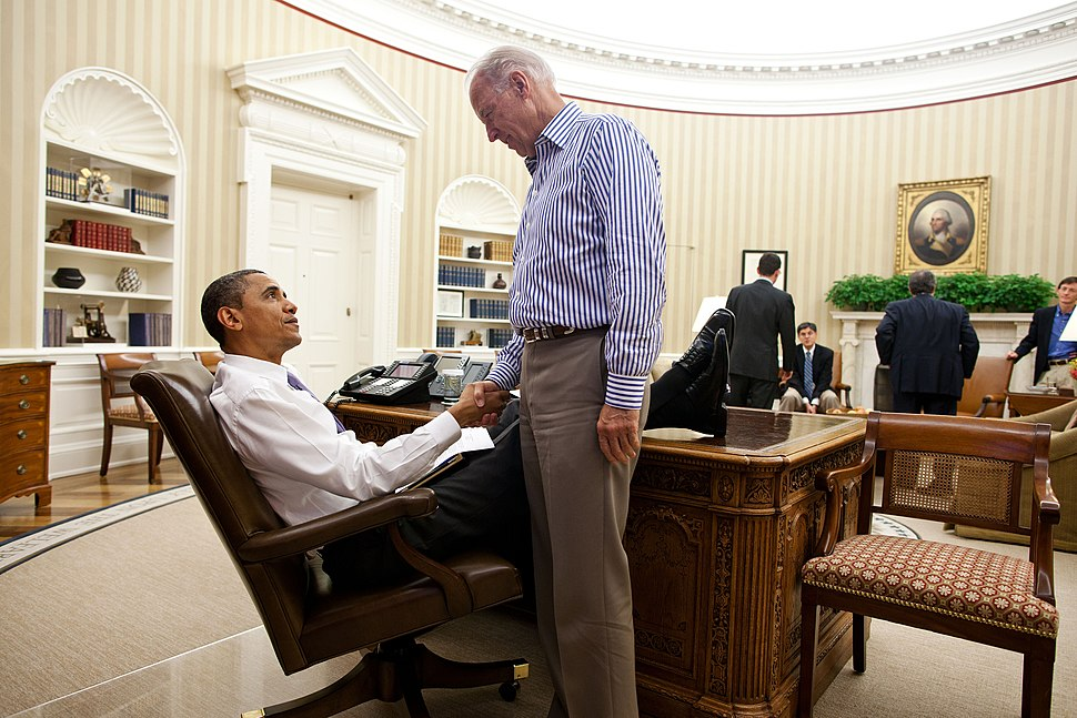 President Barack Obama and Vice President Joe Biden shake hands in the Oval Office following a phone call with House Speaker John Boehner securing a bipartisan deal to reduce the nation's deficit and avoid default
